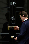 © Licensed to London News Pictures. 20/03/2013. Westminster, UK. Nick Clegg,  Liberal Democrat MP, Deputy Prime Minister, ..Chancellor Of The Exchequer George Osborne poses for photographers whilst holding his red ministerial box outside 11 Downing Street In London, before presenting his annual budget to parliament today 20th March 2013. Photo credit : Stephen Simpson/LNP