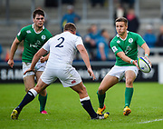 Ireland fly-half Johnny McPhillips  feeds the ball to centre Conor O'Brien during the World Rugby U20 Championship Final   match England U20 -V- Ireland U20 at The AJ Bell Stadium, Salford, Greater Manchester, England onSaturday, June 25, 2016. (Steve Flynn/Image of Sport)