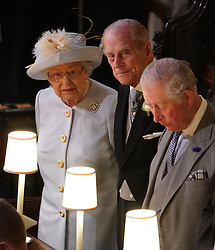 Queen Elizabeth II, the Duke of Edinburgh and the Prince of Wales at the wedding of Princess Eugenie to Jack Brooksbank at St George's Chapel in Windsor Castle.