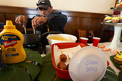 Mike Santos of Ione, Calif. prepares his deep-fried Spam Dogs at the 22nd annual Spam Festival, Sunday, Feb. 16, 2019, in Isleton, Calif. Spam lovers competed for prizes by presenting their favorite Spam-infused foods, or entering the Spam-eating and Spam-toss contests. (Photo by D. Ross Cameron)