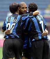 Milano 28/8/2005 Serie A 2005/2006 Inter - Treviso 3-0<br /> <br /> Adriano, centro, abbracciato da Alvaro Recoba e Luis Figo dopo il goal dell'uno a zero<br /> <br /> Adriano, Alvaro Recoba (L) and Luis Figo (R) celebrate after first goal <br /> <br /> Photo Graffiti