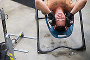 UFC lightweight Diego Sanchez of Albuquerque lays on an inversion table after training at Jackson Wink MMA in Albuquerque, New Mexico on June 9, 2016.