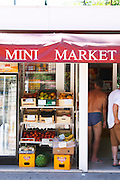 Fruit and vegetable merchant street seller shop, apples, oranges, lemons, peaches, nectarines, water melons, bananas. Sign saying Mini Market. Uvala Sumartin bay between Babin Kuk and Lapad peninsulas. Dubrovnik, new city. Dalmatian Coast, Croatia, Europe.