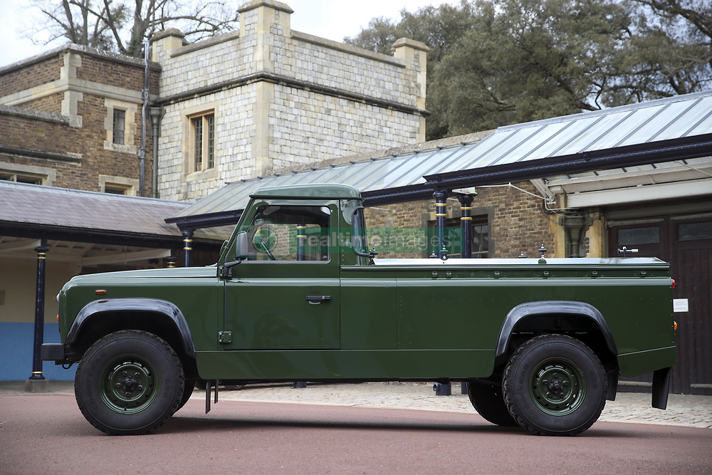 """EMBARGOED TO 1700 THURSDAY APRIL 15 The Jaguar Land Rover that will be used to transport the coffin of the Duke of Edinburgh at his funeral on Saturday, pictured at Windsor Castle, Berkshire. The modified Land Rover Defender TD5 130 chassis cab vehicle was made at Land Rover's factory in Solihull in 2003 and Philip oversaw the modifications throughout the intervening years, requesting a repaint in military green and designing the open top rear and special """"stops"""" to secure his coffin in place. Issue date: Thursday April 15, 2021."""