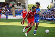 Peterborough United forward Ivan Toney (17) and Accrington Stanley defender Michael Ihiekwe (4) tussle during the EFL Sky Bet League 1 match between Peterborough United and Accrington Stanley at London Road, Peterborough, England on 20 October 2018.