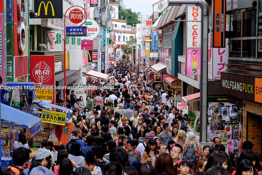 Very crowded pedestrian shopping  Takeshita Street on trendy Harajuku district of Tokyo Japan