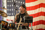 Monroe, New York - Runnin W' SiZZorZ plays at the Rhythm 'n Brews concert to benefit Museum Village on June 13, 2015.