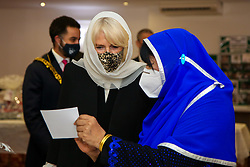 © Licensed to London News Pictures. 07/04/2021. London, UK. Camilla, Duchess of Cornwall, wearing a protective face covering and headscarf, assists with filling food hampers during a visit to the London Islamic Cultural Society and Mosque (also known as Wightman Road Mosque) in Haringey, north London. The Mosque was formed by a small group of Guyanese Muslims and now supports over 30 different nationalities and community in Haringey and surrounding boroughs. Photo credit: Dinendra Haria/LNP