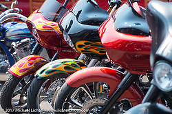 Baggers lined up at the Perewitz Paint Show at the Iron Horse Saloon during the annual Sturgis Black Hills Motorcycle Rally. SD, USA. Wednesday August 9, 2017.  Photography ©2017 Michael Lichter.