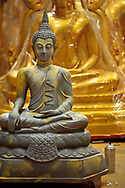 New Buddha statues being painted in a workshop at Bamrung Muaeng, Bangkok, Thailand