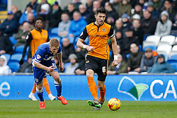Danny Batth of Wolverhampton Wanderers is challenged by Eoin Doyle of Cardiff City - Photo mandatory by-line: Rogan Thomson/JMP - 07966 386802 - 28/02/2015 - SPORT - FOOTBALL - Cardiff, Wales - Cardiff City Stadium - Cardiff City v Wolverhampton Wanderers - Sky Bet Championship.