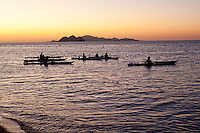 Kayakers explore Kino Bay, Mexico, at sunrise.