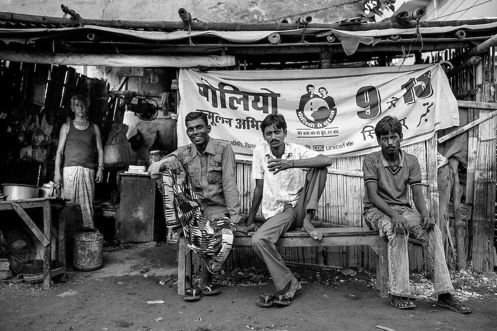 IEC material on display at a local chai stall. Patna, Bihar