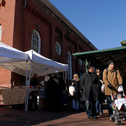 WASHINGTON, DC - Pedestrians shop for flowers and linger outside the historic Eastern Market on 7th Street in the Capitol Hill neighborhood of Washington, DC...Photo by Susana Raab