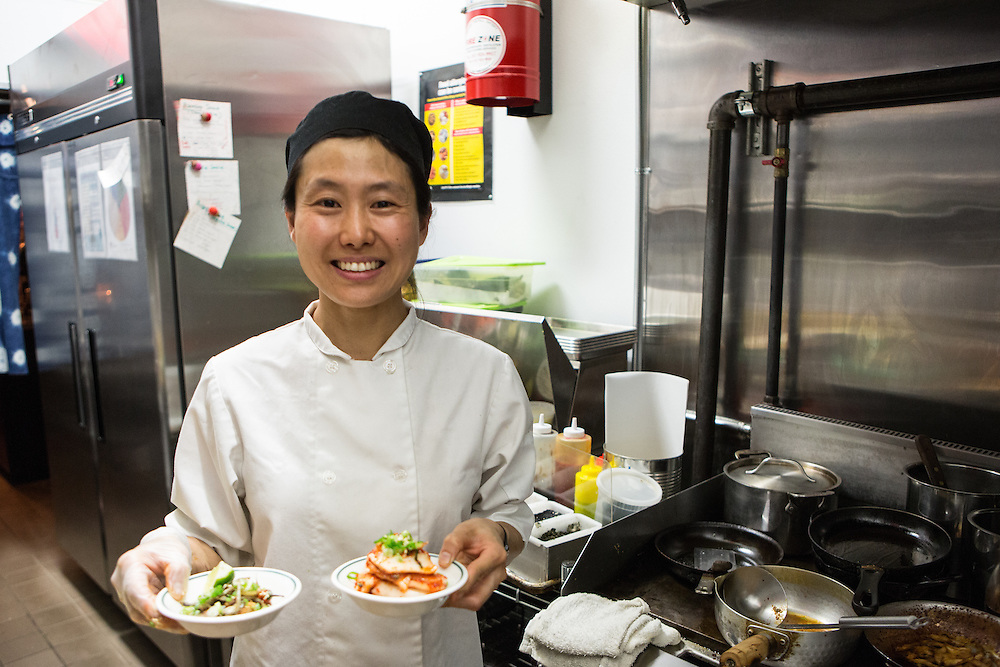 Brooklyn, NY - 26 April 2014. Chef Haegeen Kim in the kitchen at Dotory.