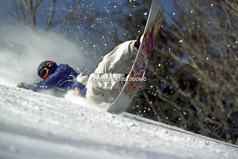 Alexandria Berntsen falling while snowboarding downhill at the 2000 Winter X-Games.