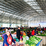 Inside the morning market building in Sam Neua (also spelled Samneua, Xamneua and Xam Neua) in northeastern Laos. A wide range of fresh fruits, vegetables, meats, fish, and cooked goods are available at the market.