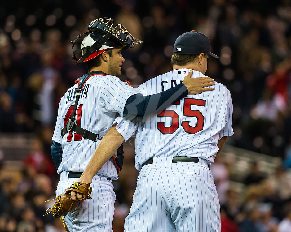 Minnesota Twins Drew Butera and Matt Capps celebrate after the Twins defeated the Los Angeles Angels on May 8, 2012 at Target Field in Minneapolis, Minnesota.  The Twins defeated the Angels 5 to 0. © 2012 Ben Krause