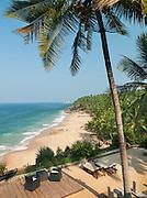 A deserted beach seen from a hotel balcony, near Kovalam and Trivandrum (Thiruvananthapuram), Kerala, India