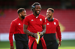 Watford's Nathaniel Chalobah inspects the pitch and reads the match programme before the Premier League match at Vicarage Road, Watford