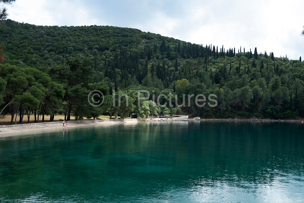 Views at Skinos beach near Vathy, Ithaca, Greece. Ithaca, Ithaki or Ithaka is a Greek island located in the Ionian Sea to the west of continental Greece. Ithacas main island has an area of 96 square kilometres. It is the second-smallest of seven main Ionian Islands.