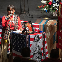 Sheila Nez begins the funeral service of her father Navajo Code Talker Joe Vandever Sr. with a welcome at El Morro Theatre Wednesday in Gallup. Over 300 people attended the service.