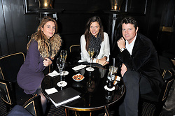 Left to right, KATE CECIL, AMANDA SHEPPARD and DR MARK CECIL at an evening of Cabaret by Nicky Haslam held in the Beaufort Bar, The Ritz, London on 11th December 2011.