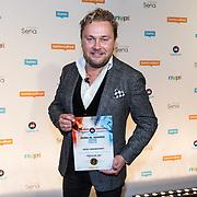NLD/Utrecht/20181001 - Buma NL Awards 2018, Wesly Bronkhorst neemt de award in ontvangst voor meest succesvolle single Hollands