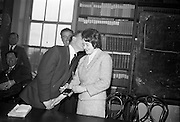 "06/05/1965<br /> 05/06/1965<br /> 06 May 1965<br /> Presentation of the Read Cup for quality Butter production at the RDS, Ballsbridge, Dublin. Image shows Mr Charles Haughey,  Minister for Agriculture giving a ""peck on the cheek"" to Miss Maura Harrington, Castletownbere Buttermakers Creamery as he presents a medal to her."