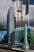 A construction hoarding showing the future skyscraper being built by housing developer Barratt at Blackfriars Circus at the southern end of Blackfriars Bridge Road, south London borough of Southwark. The merging of the future and the present make for a confusing landscape with a dark sky in the distance. In the foreground is the image of the obelisk that occupies the junction, was built in 1771. Local opposition groups object to this new landmark, one of many futuristic buildings going up to dominate the south London landscape. Typically, property in these developments are owned by foreign non-residents.