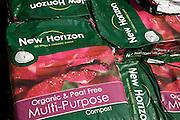 Pile of bags of New Horizon organic peat free multi-purpose compost