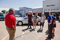 Paul Gaudet Jr, Kyle Bigler, Joanna Griffiths, Sarah Daigle, Donna Hosmer and Warren Bailey with Kyle Bigler's Honda Accord at Auto Serve of Tilton on Tuesday morning.    (Karen Bobotas/for the Laconia Daily Sun)
