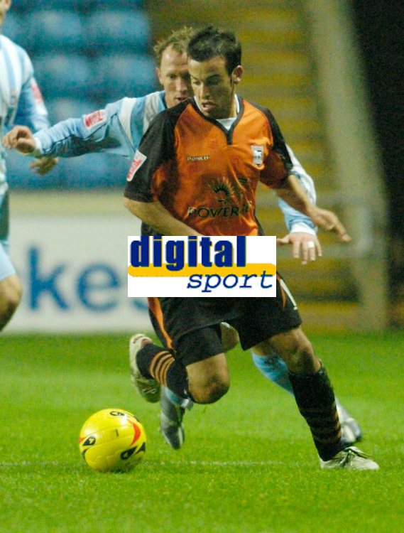 Photo: Leigh Quinnell.<br /> Coventry City v Ipswich Town. Coca Cola Championship.<br /> 19/11/2005. Ipswichs' Sito Castro keeps the ball from Coventrys Andy Morrell.