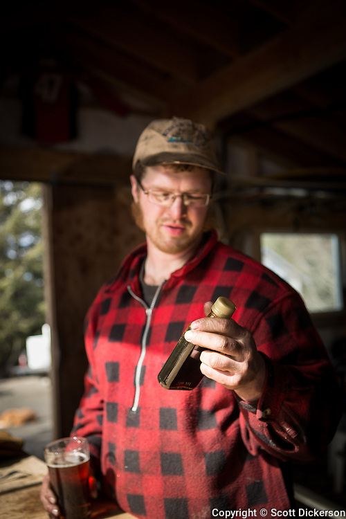 Jake Beaudoin evaporating locally collected Birch syrup in Homer, Alaska. Each spring Jake creates about 12-20 gallons of syrup that is sold locally to individuals and restaurants.