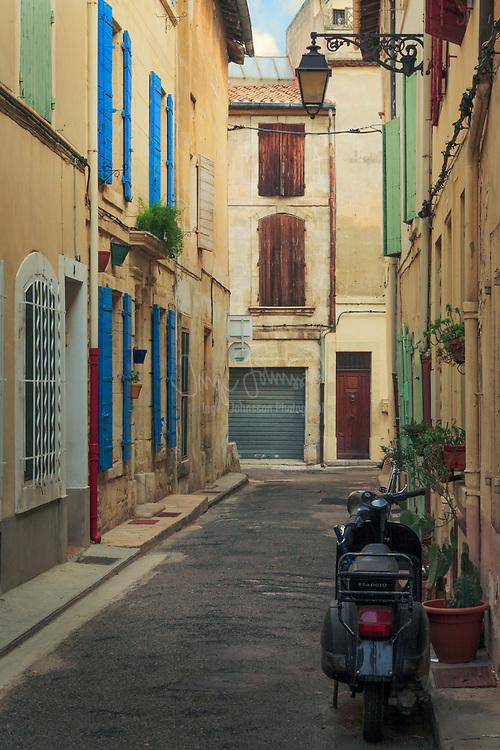 Vespa on side street in Arles, Provence, France
