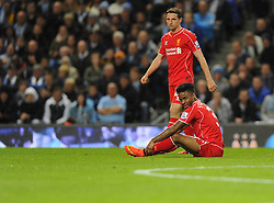 Liverpool's Raheem Sterling cuts a dejected figure with Liverpool's Joe Allen - Photo mandatory by-line: Joe Meredith/JMP - Mobile: 07966 386802 25/08/2014 - SPORT - FOOTBALL - Manchester - Etihad Stadium - Manchester City v Liverpool - Barclays Premier League