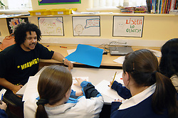 A rap artist works with children who can't attend full-time education due to their circumstances such as bullying or behavioural problems; Bradford; West Yorkshire