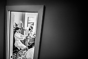 The bride during the final touches of hair and makeup at her home in Philadelphia, Pennsylvania.