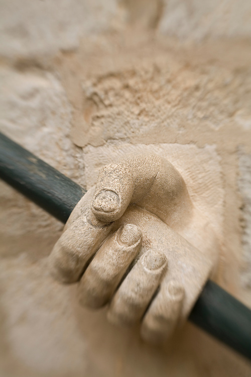 Europe, Croatia, Dalmatia, Dubrovnik.  Stone hand holding railing.  The historic center of Dubrovnik is a UNESCO World Heritage site.