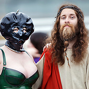 The LGBT Pride Day in Glasgow.  Elizabeth (Gimp mask) and Gordy Jeans (Jesus).  Picture Robert Perry 18th July 2014<br /> <br /> Must credit photo to Robert Perry<br /> FEE PAYABLE FOR REPRO USE<br /> FEE PAYABLE FOR ALL INTERNET USE<br /> www.robertperry.co.uk<br /> NB -This image is not to be distributed without the prior consent of the copyright holder.<br /> in using this image you agree to abide by terms and conditions as stated in this caption.<br /> All monies payable to Robert Perry<br /> <br /> (PLEASE DO NOT REMOVE THIS CAPTION)<br /> This image is intended for Editorial use (e.g. news). Any commercial or promotional use requires additional clearance. <br /> Copyright 2014 All rights protected.<br /> first use only<br /> contact details<br /> Robert Perry     <br /> 07702 631 477<br /> robertperryphotos@gmail.com<br /> no internet usage without prior consent.         <br /> Robert Perry reserves the right to pursue unauthorised use of this image . If you violate my intellectual property you may be liable for  damages, loss of income, and profits you derive from the use of this image.