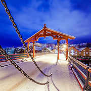 This picture has been taken after the first winter snow in Trondheim in the midnight. I like the blue sky with the white snow on top of the beautiful wooden houses. fPlease feel free to check my photos here or find me by: |Website| ,