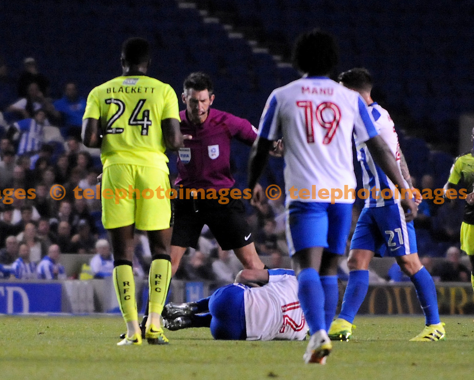 Brighton's Sebastien Pocognoli lies on the deck after a challenge from Tyler Blackett of Reading who was then shown a red card during the EFL Cup match between Brighton and Hove Albion and Reading at the American Express Community Stadium in Brighton and Hove. September 20, 2016.<br /> Liz  Finlayson / Telephoto Images<br /> +44 7967 642437