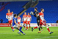 Millwall's Bartosz Bialkowski (33) saves from Cardiff City's Perry Ng (38) during the EFL Sky Bet Championship match between Cardiff City and Millwall at the Cardiff City Stadium, Cardiff, Wales on 30 January 2021.
