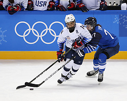 February 11, 2018 - Pyeongchang, KOREA - United States forward Brianna Decker (14) and Finland forward Susanna Tapani (77) during the women's hockey group A play during the Pyeongchang 2018 Olympic Winter Games at Kwandong Hockey Centre. The USA beat Finland 3-1. (Credit Image: © David McIntyre via ZUMA Wire)