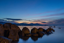 Rocks Reflecting on Sea Water at Sunset. Ko Samui, Thailand