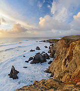 Winter surf pounds the granite sea cliffs of Bodega Head in Sonoma Coast State Park, Bodega Bay, California