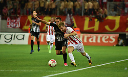 August 2, 2017 - Piraeus, Attiki, Greece - Marko Marin (no 10) of Olympiacos and Miroslav Vulicevic (no 4) of Partizan vindicate the ball during the game. (Credit Image: © Dimitrios Karvountzis/Pacific Press via ZUMA Wire)
