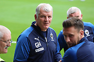 AFC Wimbledon temporary manager coach Glyn Hodges with AFC Wimbledon defender Luke O'Neill (2) during the EFL Sky Bet League 1 match between AFC Wimbledon and Rochdale at the Cherry Red Records Stadium, Kingston, England on 5 October 2019.