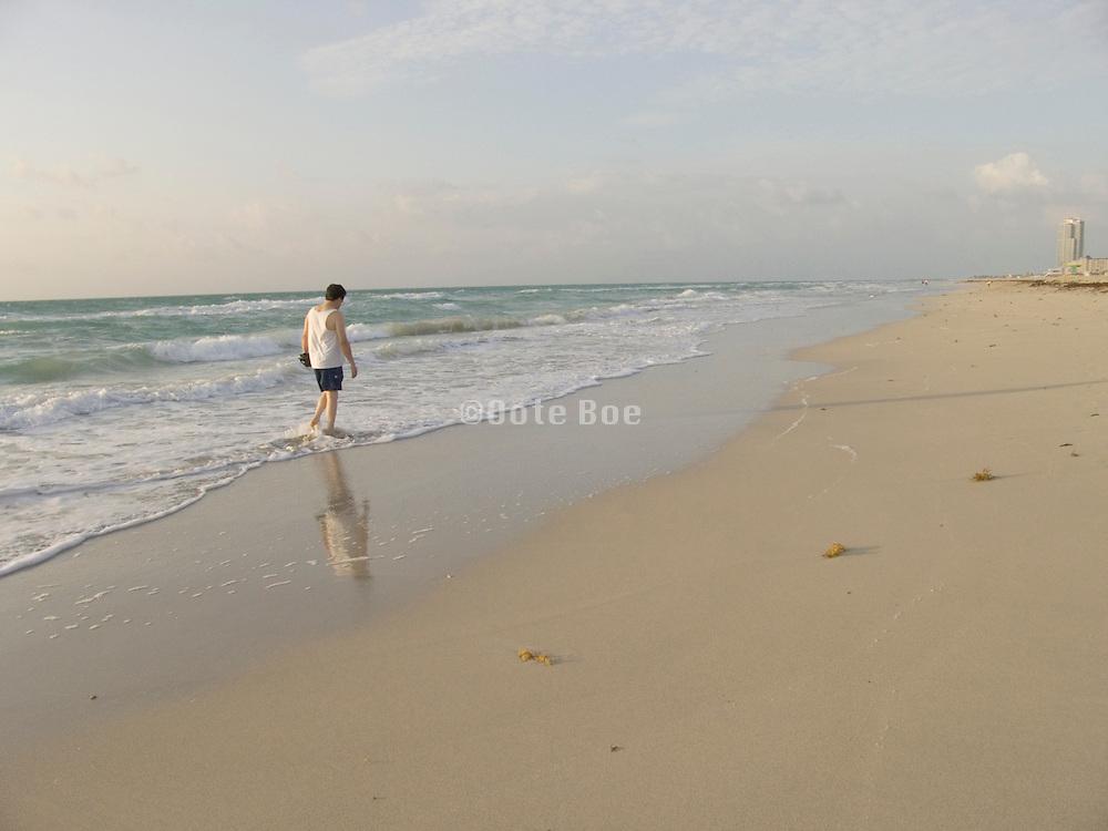 Man by himself enjoying his morning stroll Miami USA