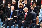 President Donald Trump reaches out to his Vice President Mike Pence during the 68th President Inaugural Ceremony on Capitol Hill January 20, 2017 in Washington, DC. Donald Trump became the 45th President of the United States in the ceremony.
